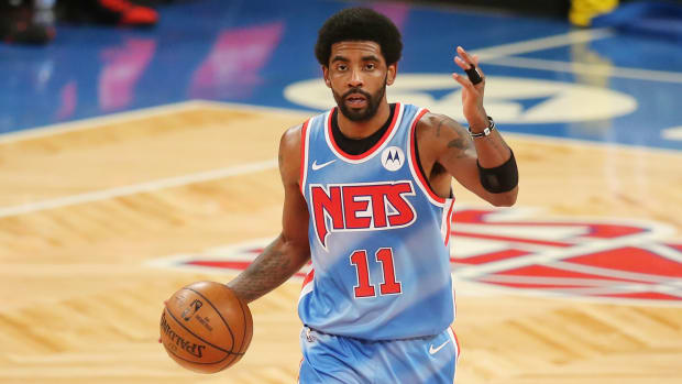 Kyrie Irving wearing a throwback Nets jersey