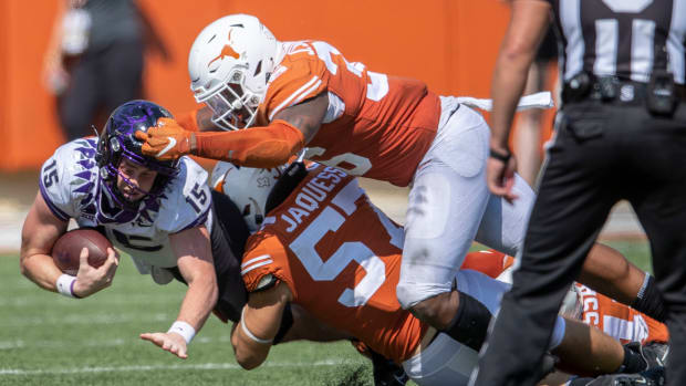 Oct 3, 2020; Austin, TX, USA; TCU Horned Frogs quarterback Max Duggan (15) fights for the first down against Texas Longhorns defensive lineman Jacoby Jones (36) and Texas Longhorns linebacker Cort Jaquess (57) in the 4th quarter in a NCAA college football game at Darrell K Royal-Texas Memorial Stadium.