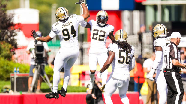 Sep 26, 2021; Foxborough, Massachusetts, USA; New Orleans Saints safety Chauncey Gardner-Johnson (22) and defensive end Cameron Jordan (94) react to a policy against New England Patriots during the first half at Gillette Stadium.