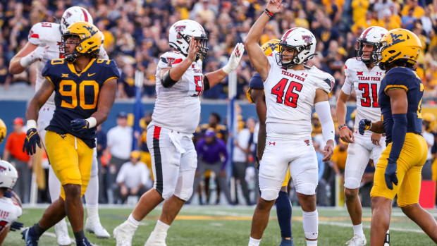 Oct 2, 2021; Morgantown, West Virginia, USA; Texas Tech Red Raiders place kicker Jonathan Garibay (46) celebrates after kicking the go ahead field goal late in the fourth quarter against the West Virginia Mountaineers at Mountaineer Field at Milan Puskar Stadium.