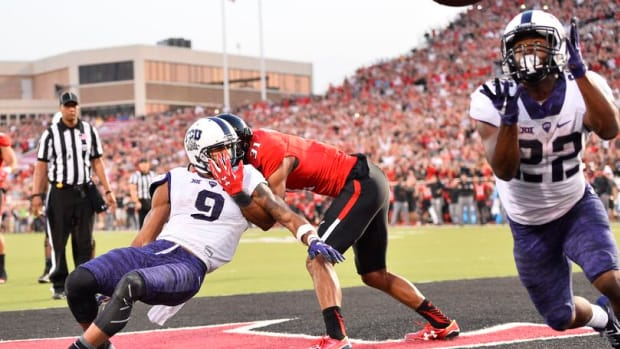 TCU tailback Aaron Green, right, catches the winning touchdown with 23 seconds left against Texas Tech after a deflection on September 26, 2015.