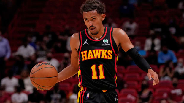 Atlanta Hawks guard Trae Young (11) dribbles the ball up the court against the Miami Heat during the first half at FTX Arena.