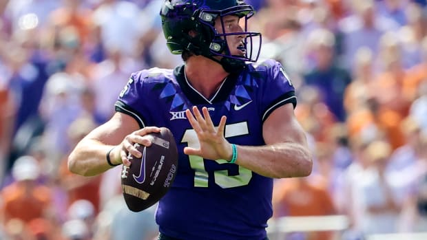 Oct 2, 2021; Fort Worth, Texas, USA; TCU Horned Frogs quarterback Max Duggan (15) throws during the second quarter against the Texas Longhorns at Amon G. Carter Stadium. Mandatory Credit: Kevin Jairaj-USA TODAY Sports