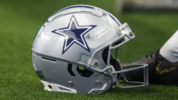 Oct 3, 2021; Arlington, Texas, USA; Detailed view of a Dallas Cowboys football helmet against the Carolina Panthers at AT&T Stadium.
