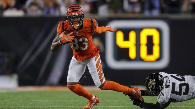 Sep 30, 2021; Cincinnati, Ohio, USA; Cincinnati Bengals wide receiver Tyler Boyd (83) runs with the ball past Jacksonville Jaguars linebacker Damien Wilson (54) in the second half at Paul Brown Stadium. Mandatory Credit: Katie Stratman-USA TODAY Sports