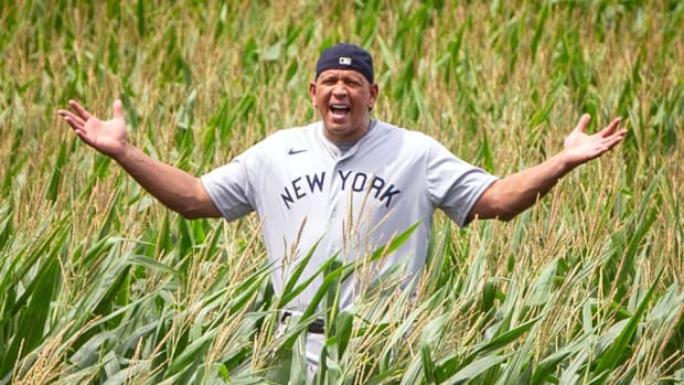 Alex Rodriguez standing in the cornfield at the 'Field of Dreams' site