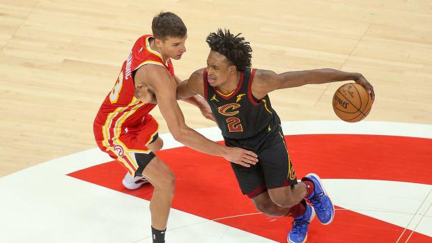 Atlanta Hawks guard Bogdan Bogdanovic (13) defends Cleveland Cavaliers guard Collin Sexton (2) in the third quarter at State Farm Arena.