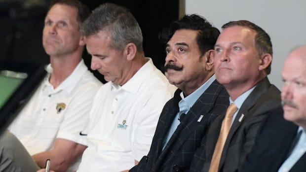 Shad Khan and Urban Meyer sit and watch during a Jaguars presentation to the city of Jacksonville