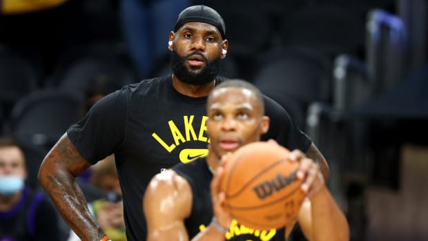 Los Angeles Lakers forward LeBron James (back) watches guard Russell Westbrook shoot prior to the preseason game against the Phoenix Suns