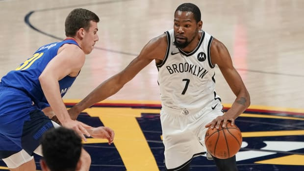 Brooklyn Nets forward Kevin Durant (7) drives against the Denver Nuggets