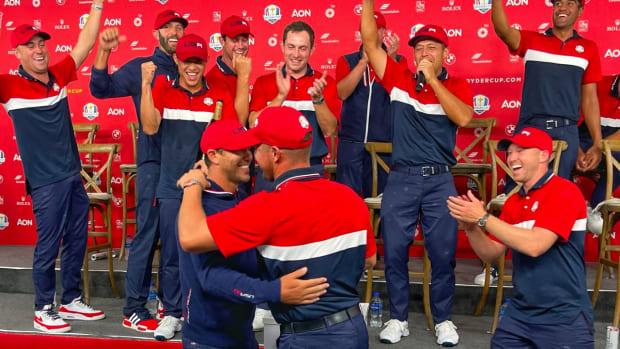 Brooks Koepka and Bryson DeChambeau hug at the Ryder Cup.