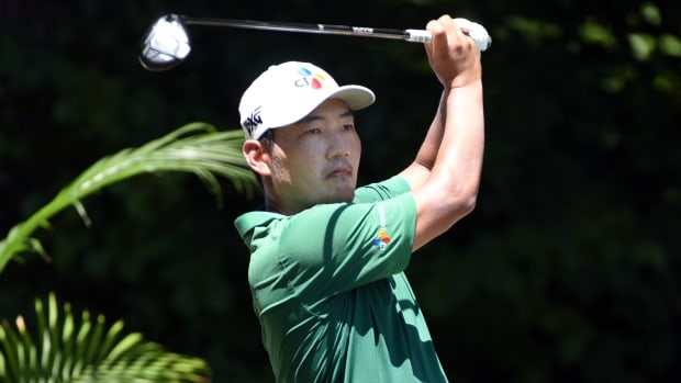 Sung Kang hits his tee shot on the second hole during the third round of the Wyndham Championship golf tournament.