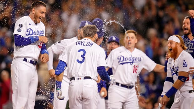Oct 6, 2021; Los Angeles, California, USA; The Los Angeles Dodgers celebrate the walk-off two run home run hit by left fielder Chris Taylor (3) against the St. Louis Cardinals during the ninth inning at Dodger Stadium. The Los Angeles Dodgers won 3-1.