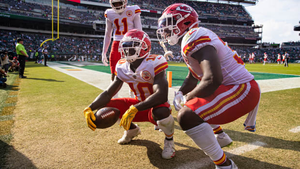 Oct 3, 2021; Philadelphia, Pennsylvania, USA; Kansas City Chiefs wide receiver Tyreek Hill (10) reacts with wide receiver Demarcus Robinson (11) and running back Darrel Williams (31) after his touchdown catch against the Philadelphia Eagles during the fourth quarter at Lincoln Financial Field. Mandatory Credit: Bill Streicher-USA TODAY Sports