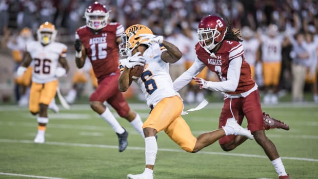 Jacob Cowing (6) receives the ball as the UTEP Minors face off against the New Mexico State Aggies at Aggie Memorial Stadium in Las Cruces on Saturday, Aug. 28, 2021.