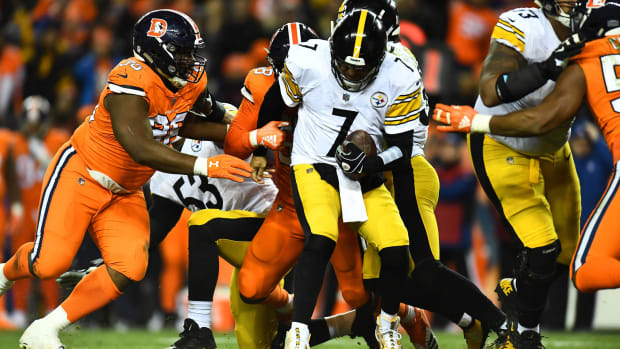 Pittsburgh Steelers quarterback Ben Roethlisberger (7) is sacked by Denver Broncos outside linebacker Von Miller (58) and defensive end Shelby Harris (96) in the fourth quarter at Broncos Stadium at Mile High.
