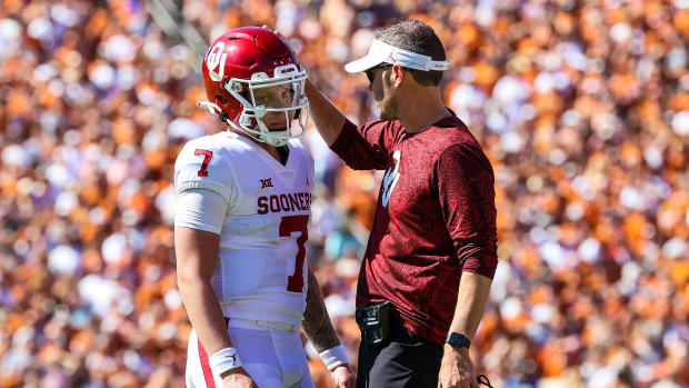 Spencer Rattler and Lincoln Riley during the Red River Showdown