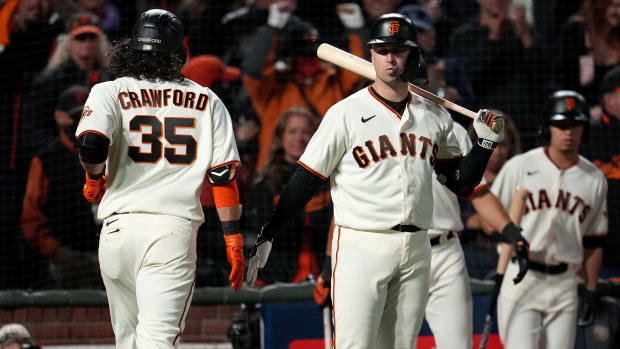 Oct 8, 2021; San Francisco, California, USA; San Francisco Giants shortstop Brandon Crawford (35) celebrates with catcher Buster Posey (28) after hitting a home run in the eighth inning against the Los Angeles Dodgers during game one of the 2021 NLDS at Oracle Park.