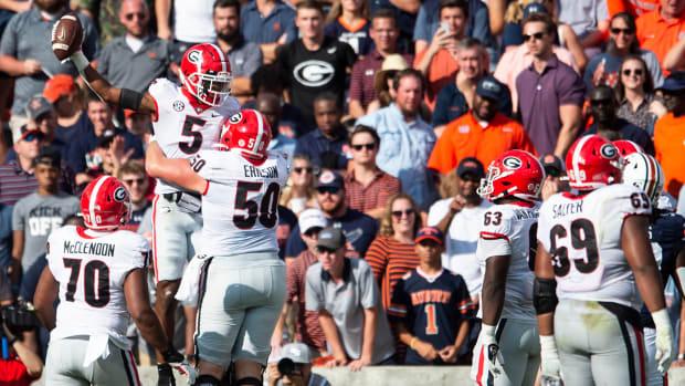 Georgia Bulldogs wide receiver Adonai Mitchell (5) celebrate his touchdown catch.