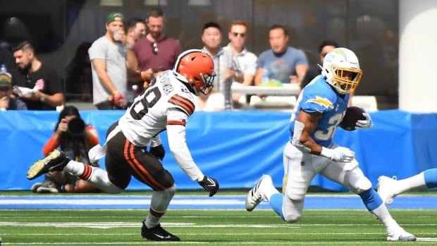 Oct 10, 2021; Inglewood, California, USA; Los Angeles Chargers running back Austin Ekeler (30) runs the ball against Cleveland Browns outside linebacker Jeremiah Owusu-Koramoah (28) in the first half at SoFi Stadium. Mandatory Credit: Richard Mackson-USA TODAY Sports