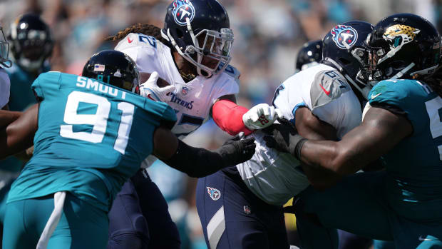 Jacksonville Jaguars defensive end Dawuane Smoot (91) attempts to tackle Tennessee Titans running back Derrick Henry (22) during the first half at TIAA Bank Field.