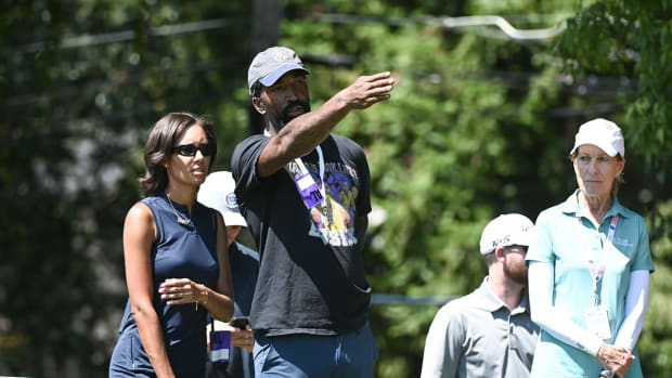 J.R. Smith watches the 2021 Tour Championship in Atlanta.