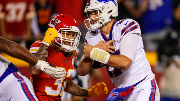 Oct 10, 2021; Kansas City, Missouri, USA; Buffalo Bills quarterback Josh Allen (17) runs for a touchdown against Kansas City Chiefs free safety Tyrann Mathieu (32) during the first half at GEHA Field at Arrowhead Stadium. Mandatory Credit: Jay Biggerstaff-USA TODAY Sports