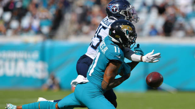 Tennessee Titans cornerback Chris Jackson (35) breaks up a pass intended for Jacksonville Jaguars wide receiver Marvin Jones Jr. (11) during late third quarter action. The Jacksonville Jaguars hosted the Tennessee Titans at TIAA Bank Field in Jacksonville, Florida, October 10, 2021.