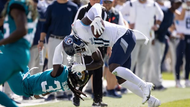 Jacksonville Jaguars cornerback Tre Herndon (37) makes a tackle on Tennessee Titans wide receiver A.J. Brown (11) during the second half at TIAA Bank Field.