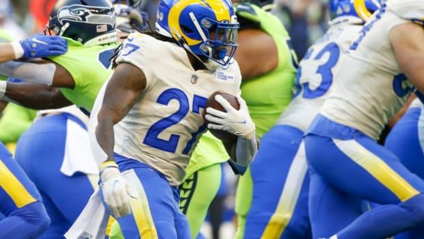Oct 7, 2021; Seattle, Washington, USA; Los Angeles Rams running back Darrell Henderson (27) runs the ball against the Seattle Seahawks during the first quarter at Lumen Field. Mandatory Credit: Joe Nicholson-USA TODAY Sports
