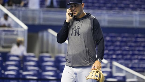 Yankees manager Aaron Boone on the phone