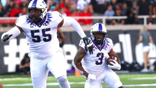 TCU Horned Frogs Emari Demercado carries the ball during the game against Texas Tech on October 9, 2021.