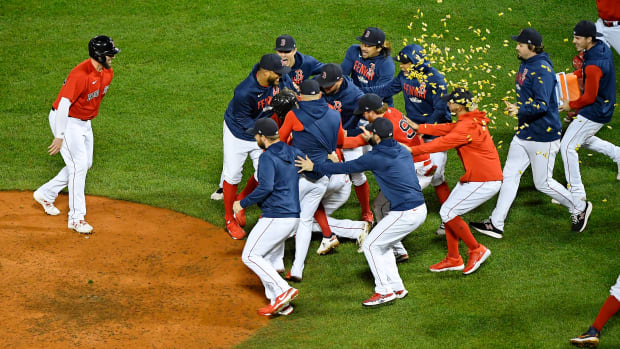 Oct 11, 2021; Boston, Massachusetts, USA; The Boston Red Sox celebrate their win over the Tampa Bay Rays in game four of the 2021 ALDS at Fenway Park.