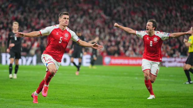 Denmark celebrates a goal vs. Austria.