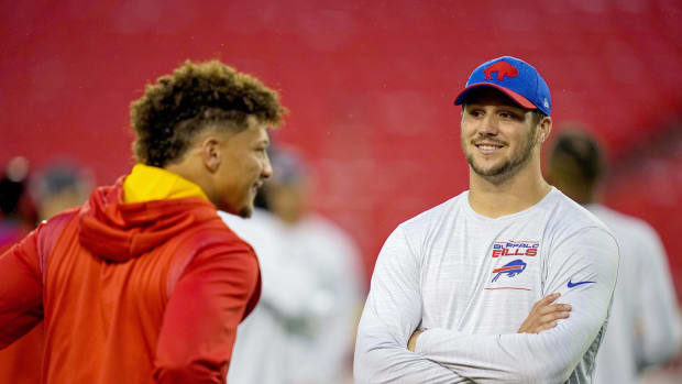 Bills quarterback Josh Allen (17) talks with Kansas City Chiefs quarterback Patrick Mahomes (15) before the game at GEHA Field at Arrowhead Stadium.