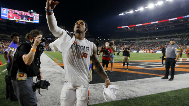 Sep 30, 2021; Cincinnati, Ohio, USA; Cincinnati Bengals wide receiver Ja'Marr Chase (1) celebrates as he leaves the field after the win as time expired against the Jacksonville Jaguars at Paul Brown Stadium. Mandatory Credit: Joseph Maiorana-USA TODAY Sports