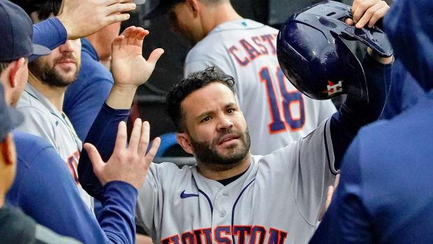 Houston Astros right fielder Kyle Tucker (30) congratulates second baseman Jose Altuve (27) after he scored on a two-run RBI double