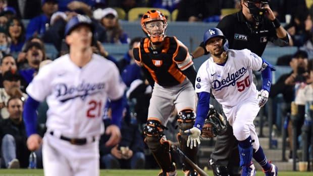 Los Angeles Dodgers right fielder Mookie Betts (50) hits a two-run home run during the fourth inning against the San Francisco Giants in game four of the 2021 NLDS at Dodger Stadium.