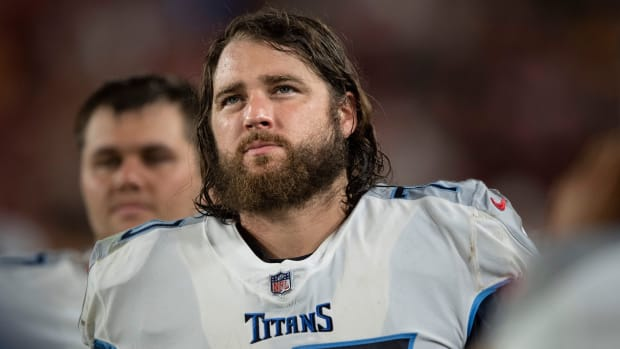 Tennessee Titans tackle Ty Sambrailo (70) walks the sideline during an NFL preseason game against the Tampa Bay Buccaneers at Raymond James Stadium Saturday, Aug. 21, 2021 in Tampa, Fla.