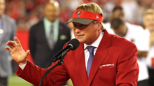 MNF announcer and former Tampa Bay Buccaneers Super Bowl winning head coach Jon Gruden speaks to the fans as he is Inducted into the Buccaneers Ring of Honor during the regular season game between the Atlanta Falcons and the Tampa Bay Buccaneers on December 18, 2017 at Raymond James Stadium in Tampa, Florida.