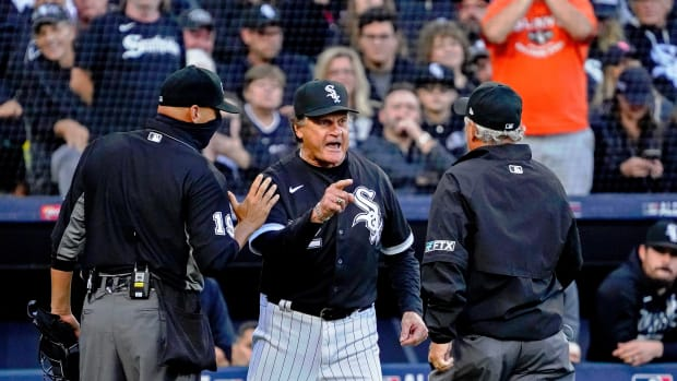 Tony La Russa confronts the umpires after his player was hit by a pitch
