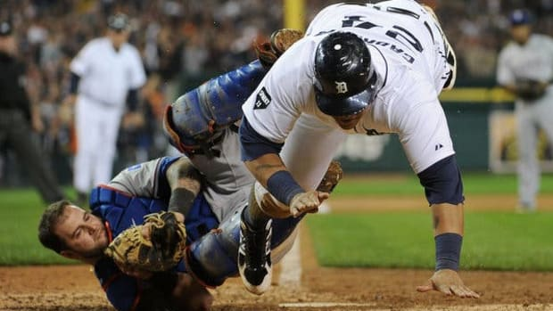 The Rangers' Mike Napoli tagged out Miguel Cabrera for the final out of the eighth inning to preserve a 3-3 tie. Texas would blow the game open with a 4-run 11th inning.