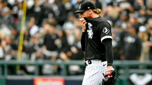 Oct 12, 2021; Chicago, Illinois, USA; Chicago White Sox starting pitcher Michael Kopech (34) reacts after a play against the Houston Astros during the fourth inning in game four of the 2021 ALDS at Guaranteed Rate Field.