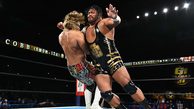 Jeff Cobb hits an opponent with a clothesline