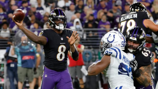 Lamar Jackson throws a pass from the pocket