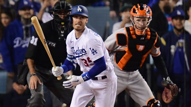 Los Angeles Dodgers center fielder Cody Bellinger (35) hits in to a fielders choice to San Francisco Giants first baseman Darin Ruf (33) in the third inning during game four of the 2021 NLDS