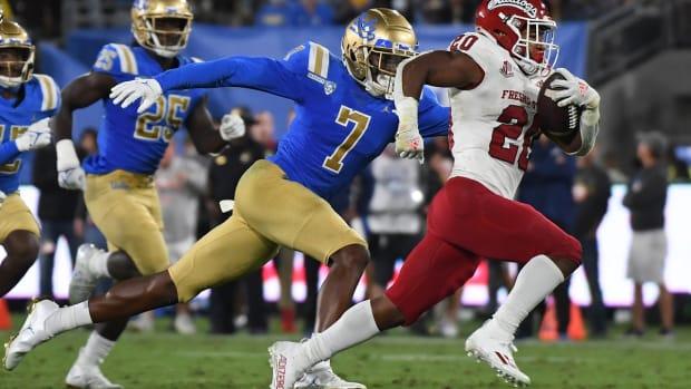 Sep 18, 2021; Pasadena, California, USA; Fresno State Bulldogs running back Ronnie Rivers (20) runs against UCLA Bruins defensive back Mo Osling III (7) in the third quarter at Rose Bowl. Mandatory Credit: Richard Mackson-USA TODAY Sports