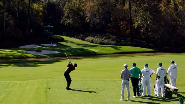 Tiger Woods hits a shot on the par-3 12th hole during the 2020 Masters.