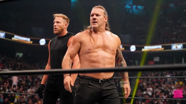 A shirtless Chris Jericho in the ring on Dynamite with Jake Hager behind him