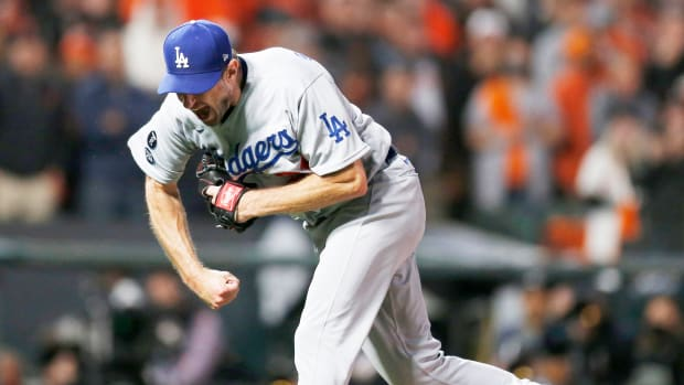 Oct 14, 2021; San Francisco, California, USA; Los Angeles Dodgers pitcher Max Scherzer (31) celebrates recording the final out against the San Francisco Giants in the ninth inning during game five of the 2021 NLDS at Oracle Park.